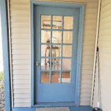 Other side of door. The implement is a broom to sweep off spiders.