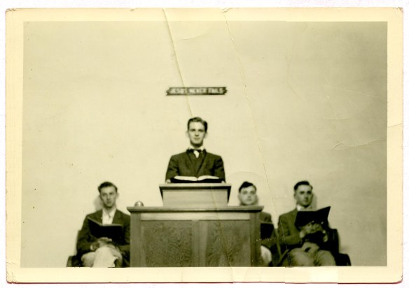 Richard Sauder in pulpit, to the right Parke Garber, extreme right Ray Longenecker, my father  (Unidentified man at left)