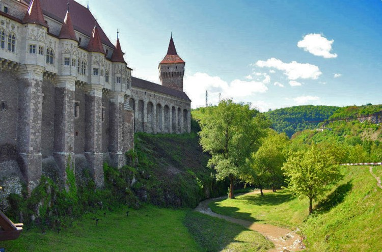 Corvin Castle surrounded by lush vegetation