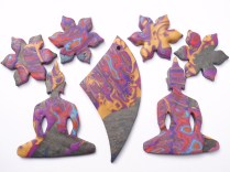 polymer clay buddha and narcissus pendants