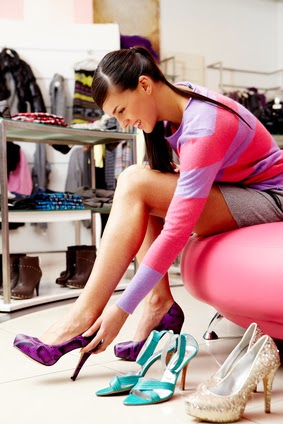 Image of lady trying on several pairs of new shoes in the mall