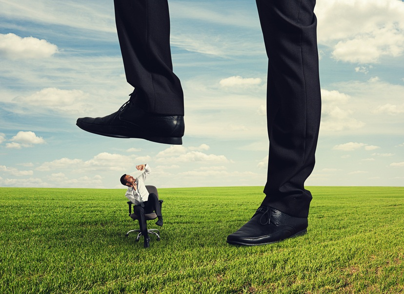 boss trampling down bad worker in the land