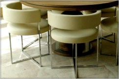 Porada Anxi chairs in cream leather at Marie Charnley Interiors
