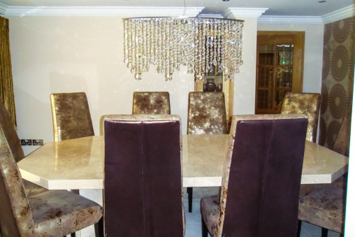 Bespoke hexagonal table with bespoke copper and gold leather chairs by Stone International at Marie Charnley Interiors