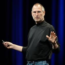 Steve Jobs delivering a keynote wearing his signature black turtleneck and jeans. Used to explain the value of a capsule closet to eliminate unnecessary choices in a productive person's day. Featured in the Efficient Entrepreneurs Not TO DO list on mariedeveaux.com