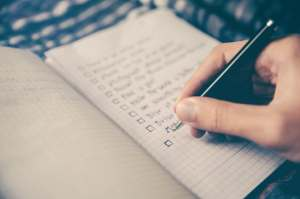 "handwritten to do list with checkboxes depicted in article ""The Efficient Entrepreneurs Not TO DO List"" on mariedeveaux.com career coach, business coach New York and Brooklyn"