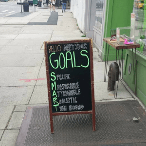 SMART goals sandwich board on Flatbush Avenue Brooklyn from Marie Deveaux career coach on New Year's resolutions and planning