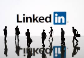 Image of people networking under the banner of the LInkedIN Lgo as accompanied by 5 tips on making LinkedIn work into your busy mompreneur schedule