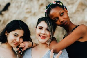 Image of three women friends looking relaxed and happy as featured in mariedeveaux.com career coach website about healthy relationships. Photo by Omar Lopez on Unsplash