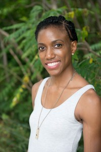 """Marie Deveaux, Career Coach smiles for the camera as she recalls her career journey as a series of awakenings and virtual """"birth"""" days."""