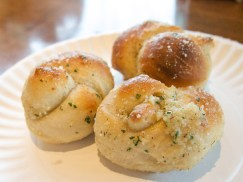 Three garlic knots on a paper plate as Marie Deveaux Career Coach explains the control and power in career transitions on mariedeveaux.com