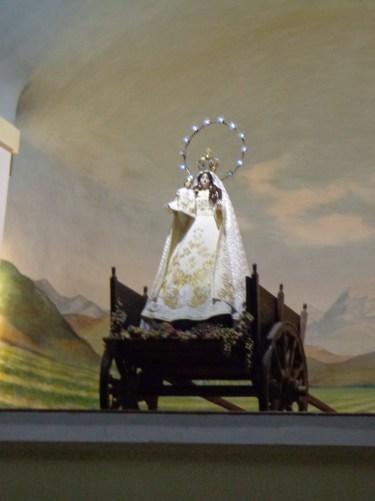 Virgen de la Carrodilla sobre un carro lleno de uvas