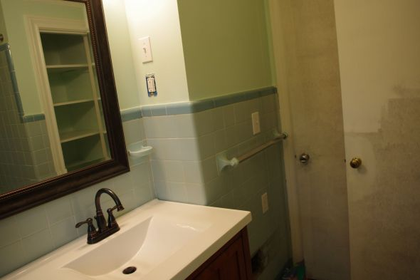 "My new bathroom. I painted ""Open"" to hang on the wall over the towel bar."