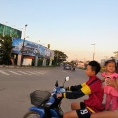 A little girl on a motorcycle