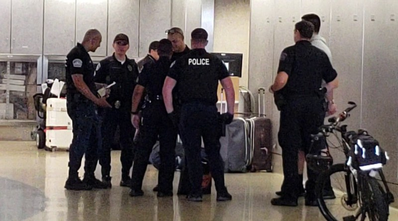 LAX airport police making an arrest a man with MARIJUANA