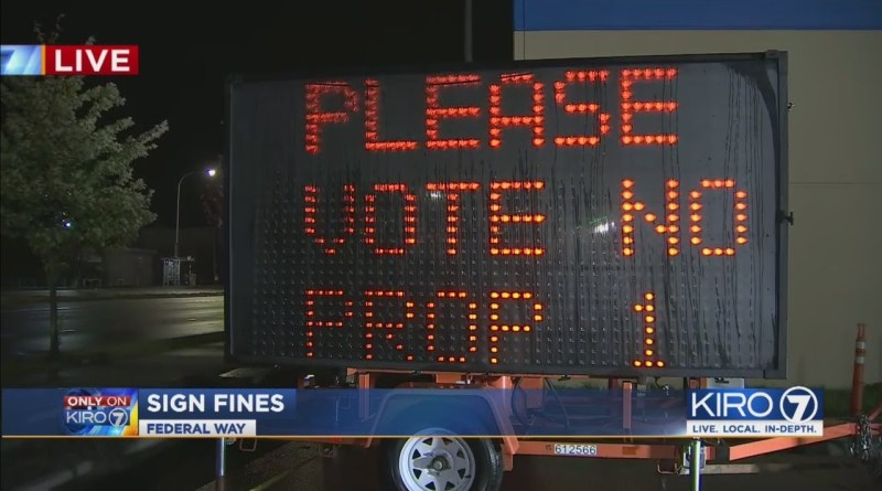 VIDEO: Signs with opposing views on marijuana put up in Federal Way