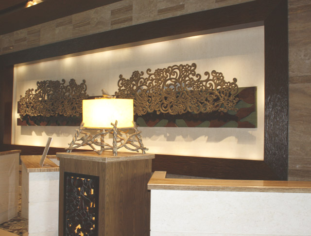 The reception counter had a backdrop of intricate wood cut outs.