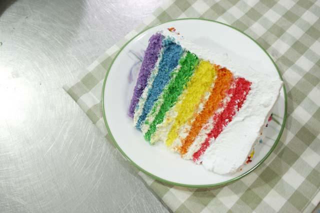 a rainbow cake slice