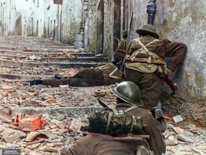 Canadian infantrymen advance cautiously up a narrow lane in Campochiaro, Italy, on Nov. 11, 1943.