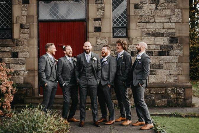 A groom and his groomsmen laughing