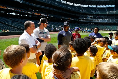 Mariners Head Athletic Trainer Rick Griffin, pitcher Mark Lowe and Second baseman Robinson Cano meet with kids from the Rainier Vista Boys & Girls Club during the PLAY event.