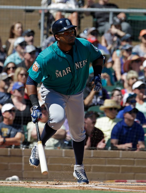 Seattle Mariners' Nelson Cruz hits an RBI single during the first inning of a spring training baseball game against the Colorado Rockies, Thursday, March 24, 2016, in Scottsdale, Ariz. (AP Photo/Darron Cummings)