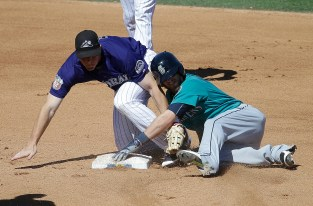 Seattle Mariners' Shawn O'Malley, right, slides safely into second for a double as Colorado Rockies' DJ LeMahieu takes the throw during the fourth inning of a spring training baseball game Thursday, March 24, 2016, in Scottsdale, Ariz. (AP Photo/Darron Cummings)