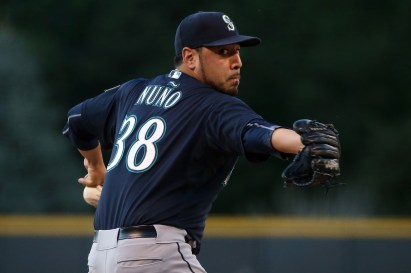 DENVER, CO - AUGUST 04: Starting pitcher Vidal Nuno #38 of the Seattle Mariners delivers against the Colorado Rockies during interleague play at Coors Field on August 4, 2015 in Denver, Colorado. (Photo by Doug Pensinger/Getty Images)