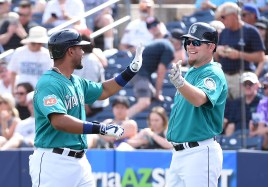 PEORIA, AZ - MARCH 02: Franklin Gutierrez #21 of the Seattle Mariners and teammate Adam Lind #26 celebrate a fourth inning home run against the San Diego Padres at Peoria Stadium on March 2, 2016 in Peoria, Arizona. Mariners won 7-0. (Photo by Norm Hall/Getty Images)