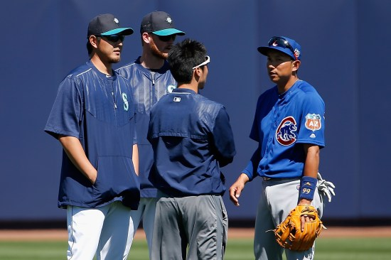 PEORIA, AZ - MARCH 10: Pitcher Hisashi Iwakuma #18 (L) of the Seattle Mariners talks with Munenori Kawasaki #66 (R) of the Chicago Cubs before the spring training game at Peoria Stadium on March 10, 2016 in Peoria, Arizona. (Photo by Christian Petersen/Getty Images)