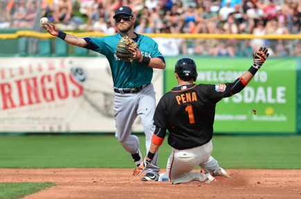 SCOTTSDALE, AZ - MARCH 11: Shawn O'Malley #36 of the Seattle Mariners turns the double play over the sliding Ramiro Pena #1 of the San Francisco Giants in the third inning at Scottsdale Stadium on March 11, 2016 in Scottsdale, Arizona. (Photo by Jennifer Stewart/Getty Images)
