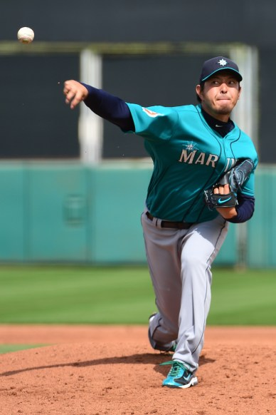 SCOTTSDALE, AZ - MARCH 11: Starting pitcher Hisashi Iwakuma #18 of the Seattle Mariners delivers a pitch in the second inning of the spring training game against the San Francisco Giants at Scottsdale Stadium on March 11, 2016 in Scottsdale, Arizona. (Photo by Jennifer Stewart/Getty Images)