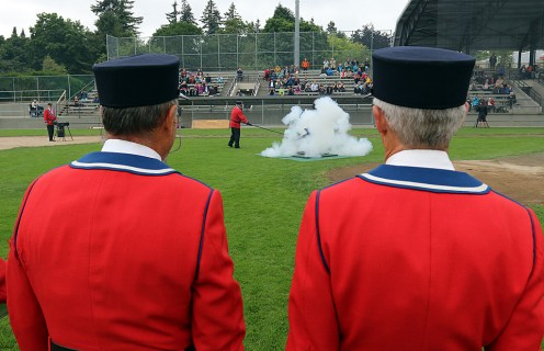 Members of the Hyack Anvil Battery look on during the annual Vcitoria Day 21-gun salute to the Queen at Queen's Park Stadium. Photo by Mario Bartel