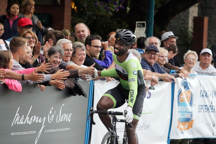MARIO BARTEL PHOTO American Justin Williams celebrates his win in the men's race with fans along Shaugnessy Street.