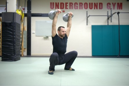 greg_mihovich_double_overhead_kettlebell_squat