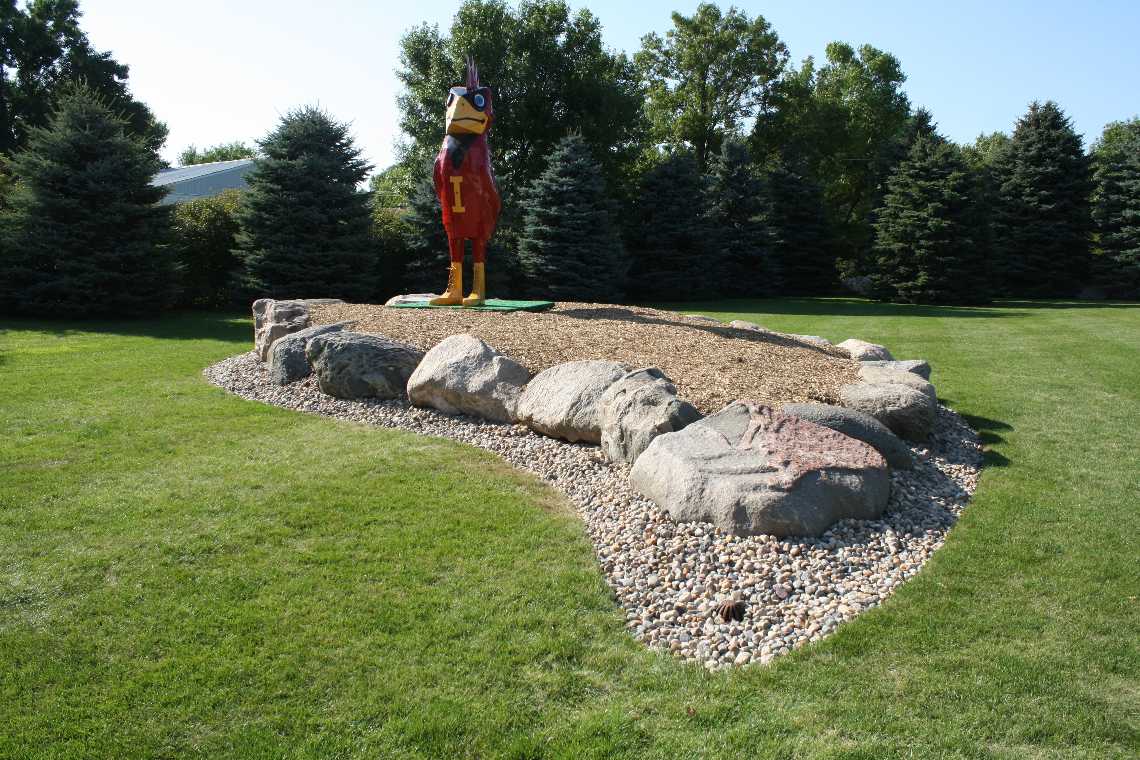 Cy, built in 1975 by my 1981 Cy's Favorite Alum father, Deane Gunderson. The boulders are arranged in the shape of a cyclone.  Also, on the front/tip boulder is a natural reddish large abstract shape of a cyclone.  (Click photo to enlarge.)