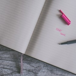 notebook with 'start today' in pink ink, beat writer's block