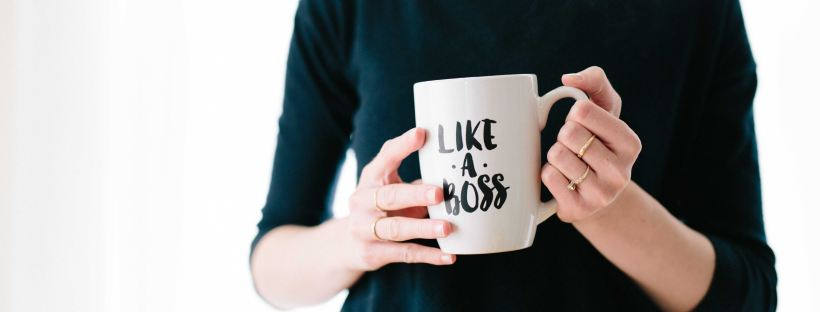 keep from going stagnant, woman with 'like a boss' mug