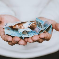 desired freelance rate, person holding money