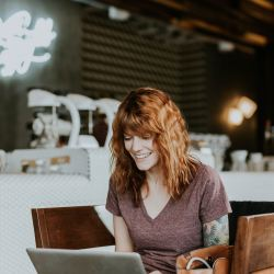 how to start an online store, girl on computer in shop