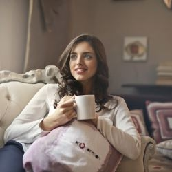 work-life balance, happy woman with coffee on couch