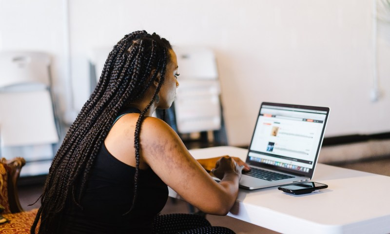 woman doing work as a reminder that you're never done