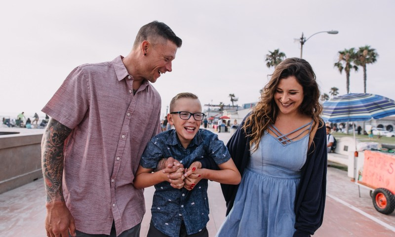 happy family learning to spread kindness