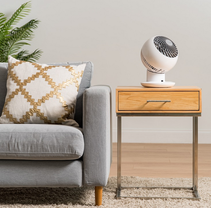 fan sitting on a desk in a home or office space