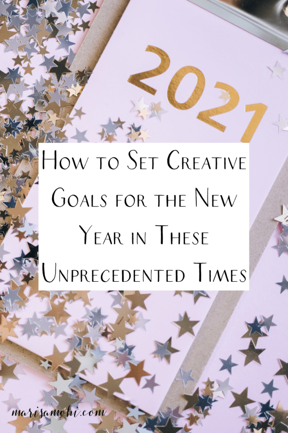 "A clipboard with a piece of paper on it that says 2021 with the text ""how to set creative goals for the new year in these unprecedented times"""