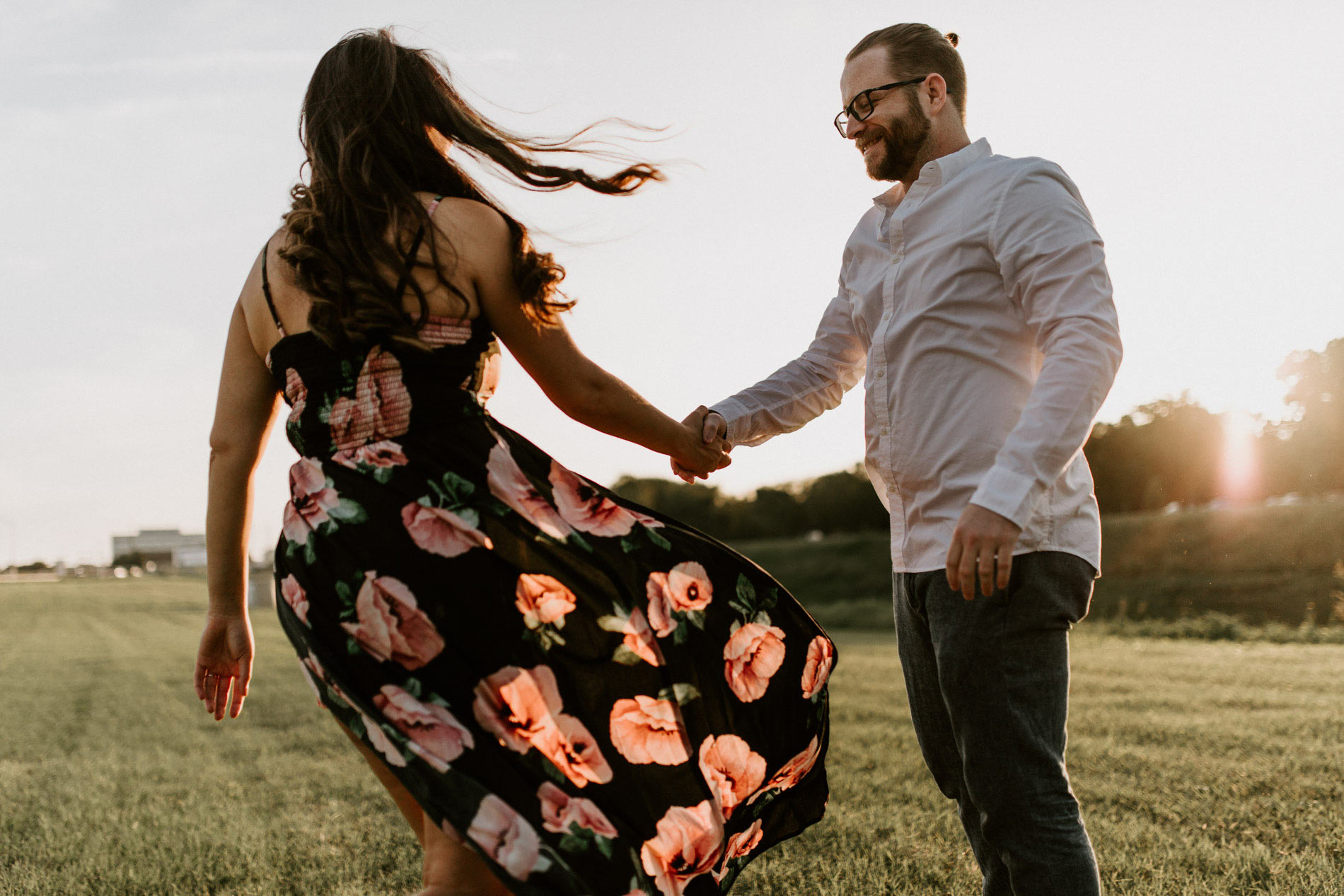 girl and boy playing around during engagement photos in Fort Worth