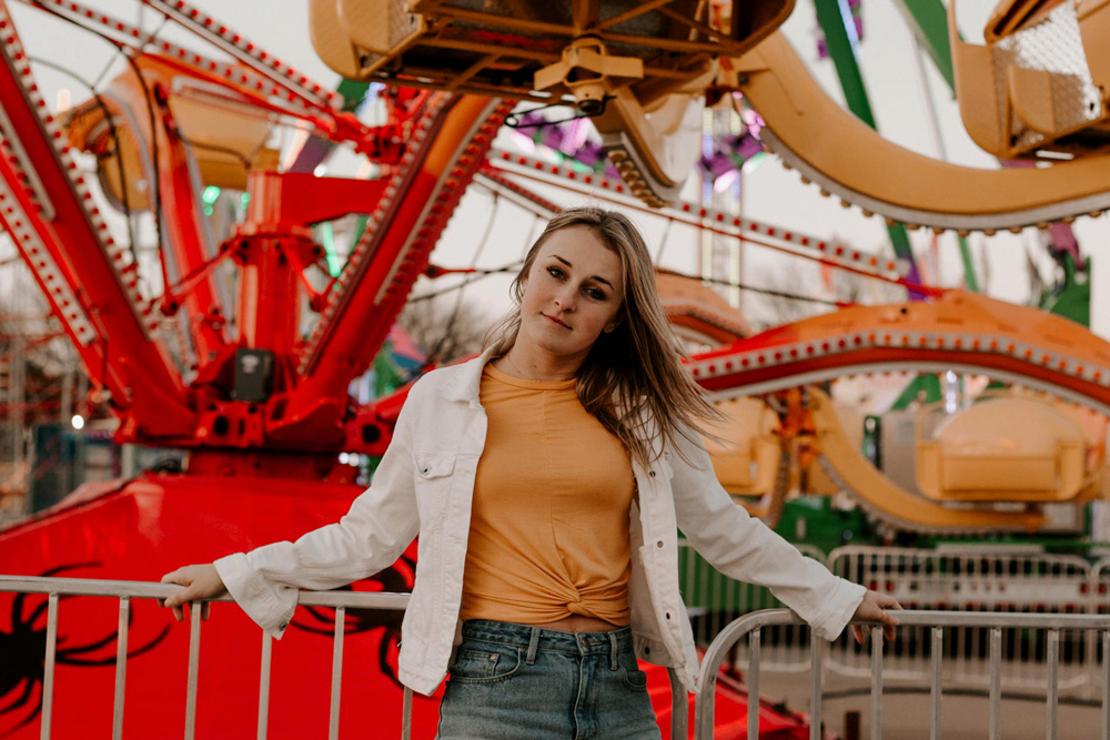 girl looking at camera at a carnival
