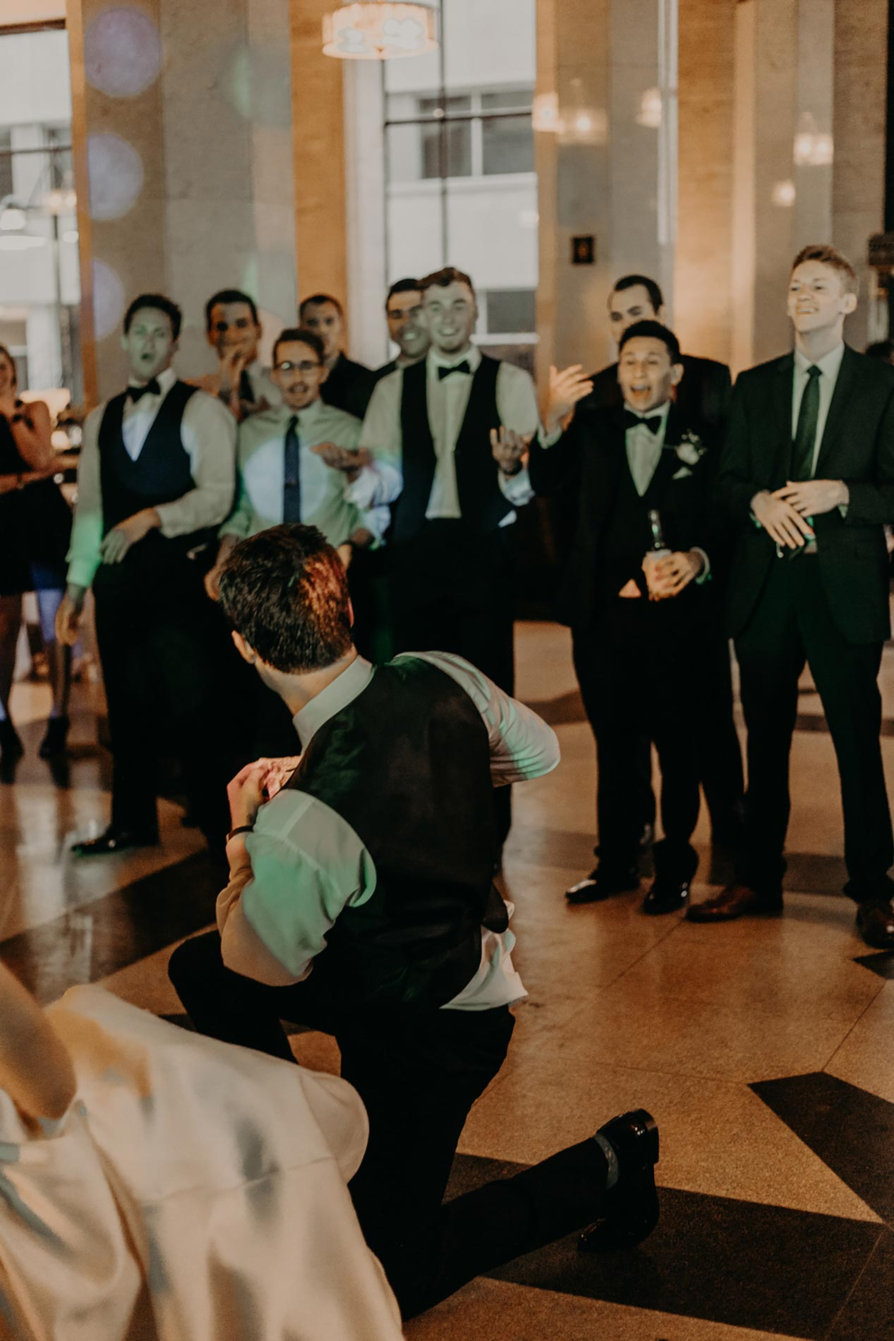 groom throwing the garter after wedding ceremony