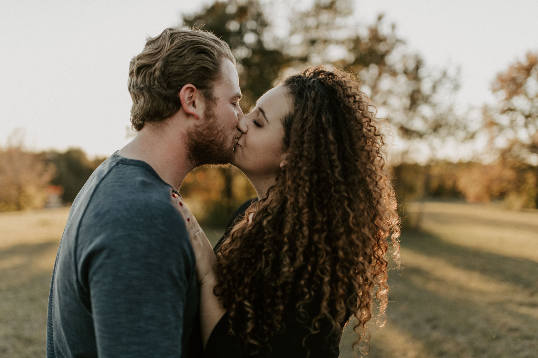 adorable couple kissing during engagement session in Tyler Texas