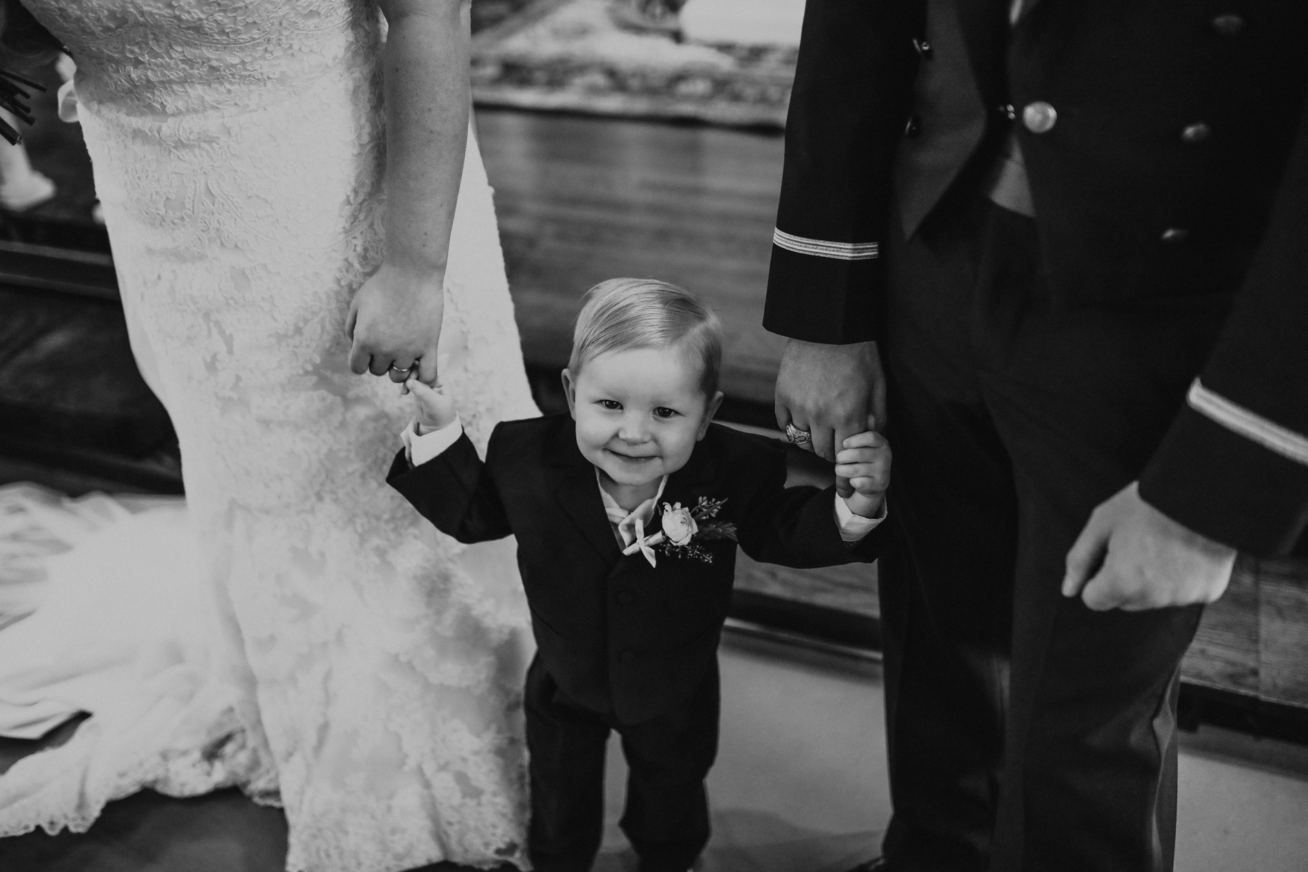 adorable ring bearer after wedding ceremony
